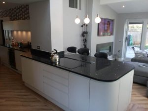 White kitchen with black gloss worktops