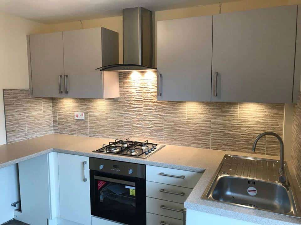 new kitchen light cabinetry and worktops