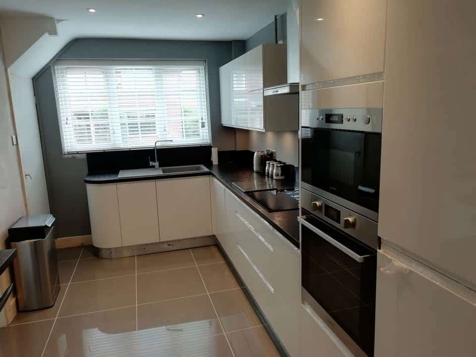 New fitted kitchen white units black worktops
