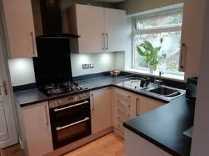 fitted kitchen with black splashback