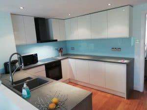fitted kitchen blue and white, dark worktops