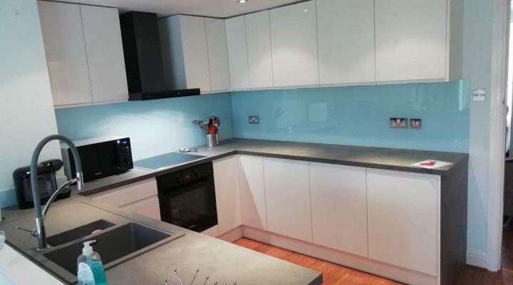 fitted kitchen blue and white, dark worktops